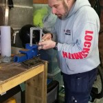 Our locksmith Jason using a key saw to cut a key.