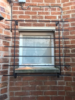 Security Grills Fitted To Store Window In Melton Mowbray