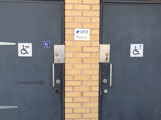 Toilet Doors After Steel Plate Added For Extra Security